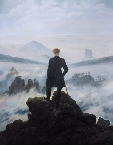 painting of a man standing on a rock, looking into the fog