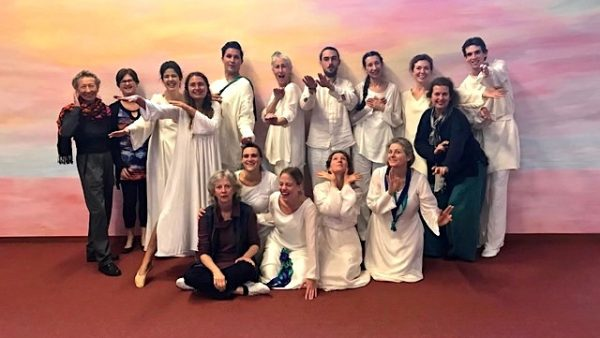 a picture of students of eurythmy dressed in long veils and tights